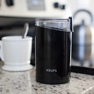 KRUPS<sup>®</sup> F203 Grinder - This coffee and spice grinder has a unique oval shape to ensure uniform grinding results.  Powerful 200-watt motor is fast and efficient and features a stainless steel blade and 3 oz. chamber capacity.