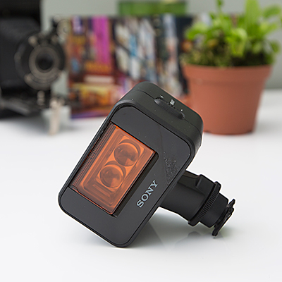 SONY<sup>&reg;</sup> HandyCam<sup>&reg;</sup> Cyber-shot IR Light - This battery video IR light features built-in color filter and adjustable illuminance.  Mounts with ni multi interface shoe and two AA batteries.  Approximately 2.5W center luminous intensity with 30 degree lighting angle and 1500lx.