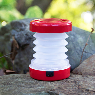 "EASYLIVING™ Mini Collapsible Camping Lantern - Easy to pack and store, this collapsible camping lantern features 5 bright LEDs.  Push button feature changes lantern from bright to blinking.  Measures 3½""H x 2½""W. Requires 3 AAA batteries, not included."